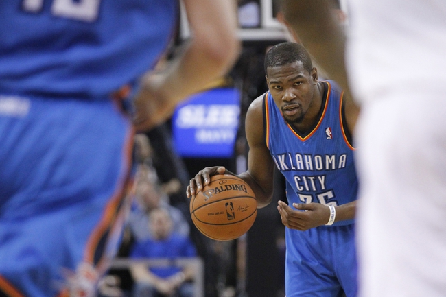 Apr 8, 2014; Sacramento, CA, USA; Oklahoma City Thunder forward Kevin Durant (35) dribbles the ball against the Sacramento Kings in the second quarter at Sleep Train Arena. Mandatory Credit: Cary Edmondson-USA TODAY Sports