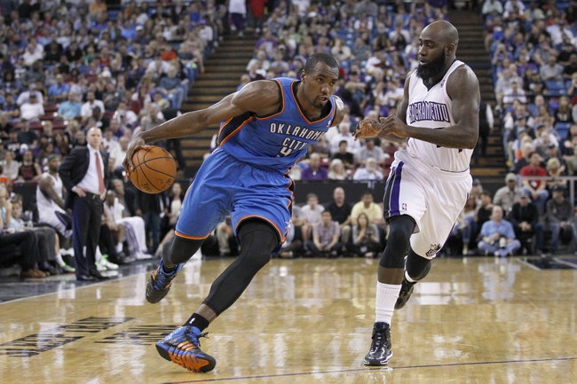 Apr 8, 2014; Sacramento, CA, USA; Oklahoma City Thunder forward Serge Ibaka (9) dribbles past Sacramento Kings forward Quincy Acy (5) in the second quarter at Sleep Train Arena. Mandatory Credit: Cary Edmondson-USA TODAY Sports