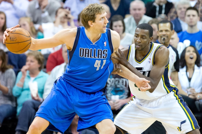 Apr 8, 2014; Salt Lake City, UT, USA; Utah Jazz forward Jeremy Evans (40) defends against Dallas Mavericks forward Dirk Nowitzki (41) during the second half at EnergySolutions Arena. The Mavericks won 95-83. Mandatory Credit: Russ Isabella-USA TODAY Sports