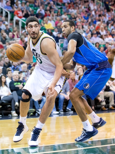 Apr 8, 2014; Salt Lake City, UT, USA; Dallas Mavericks forward Brandan Wright (34) defends against Utah Jazz center Enes Kanter (0) during the second half at EnergySolutions Arena. The Mavericks won 95-83. Mandatory Credit: Russ Isabella-USA TODAY Sports