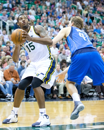 Apr 8, 2014; Salt Lake City, UT, USA; Dallas Mavericks forward Dirk Nowitzki (41) defends against Utah Jazz center Derrick Favors (15) during the second half at EnergySolutions Arena. The Mavericks won 95-83. Mandatory Credit: Russ Isabella-USA TODAY Sports