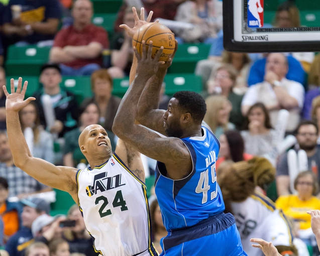 Apr 8, 2014; Salt Lake City, UT, USA; Utah Jazz forward Richard Jefferson (24) defends against Dallas Mavericks center DeJuan Blair (45) during the second half at EnergySolutions Arena. The Mavericks won 95-83. Mandatory Credit: Russ Isabella-USA TODAY Sports