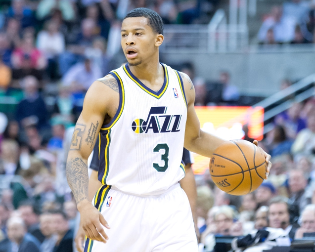 Apr 8, 2014; Salt Lake City, UT, USA; Utah Jazz guard Trey Burke (3) controls the ball during the second half against the Dallas Mavericks at EnergySolutions Arena. The Mavericks won 95-83. Mandatory Credit: Russ Isabella-USA TODAY Sports