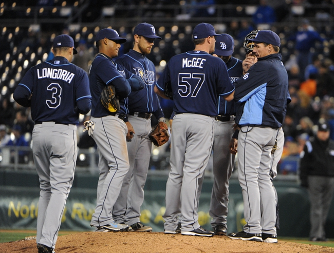 Apr 8, 2014; Kansas City, MO, USA; Tampa Bay Rays relief pitcher Jake McGee (57) is visited by the infield in the eighth inning against the Kansas City Royals at Kauffman Stadium. Tampa Bay won the game 1-0. Mandatory Credit: John Rieger-USA TODAY Sports