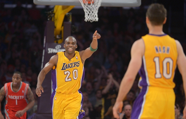 Apr 8, 2014; Los Angeles, CA, USA; Los Angeles Lakers guard Jodie Meeks (10) acknowledges Steve Nash (10) after Meeks scored on assist by Nash to pass Mark Jackson (not pictured) to move into third on the all-time NBA assist list in the second quarter against the Houston Rockets at Staples Center. Mandatory Credit: Kirby Lee-USA TODAY Sports