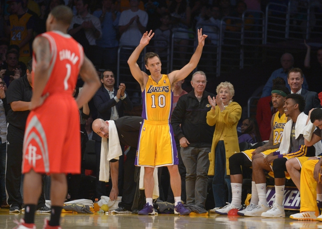 Apr 8, 2014; Los Angeles, CA, USA; Los Angeles Lakers guard Steve Nash (10) acknowledges the crowd after passing Mark Jackson (not pictured) to move into third on the all-time NBA assist list in the second quarter against the Houston Rockets at Staples Center. Mandatory Credit: Kirby Lee-USA TODAY Sports