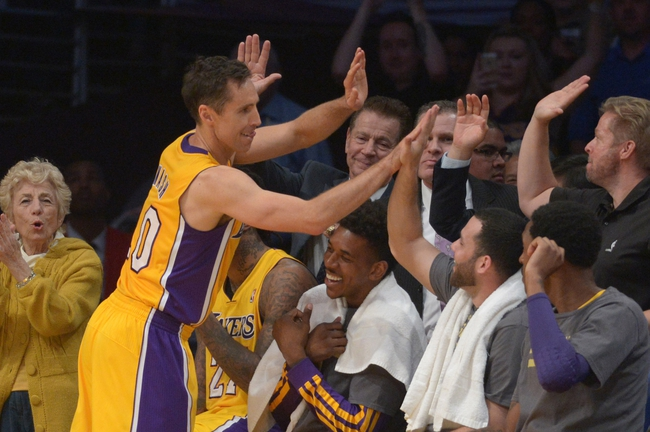 Apr 8, 2014; Los Angeles, CA, USA; Los Angeles Lakers guard Steve Nash (10) is congratulated by teammates Jodie Meeks (10), Nick Young (0) and Jordan Farmar (1) after passing Mark Jackson (not pictured) to move into third on the all-time NBA assist list in the second quarter against the Houston Rockets at Staples Center. Mandatory Credit: Kirby Lee-USA TODAY Sports