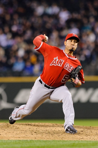 Apr 8, 2014; Seattle, WA, USA; Los Angeles Angels relief pitcher Fernando Salas (59) pitches to the Seattle Mariners during the sixth inning at Safeco Field. Mandatory Credit: Steven Bisig-USA TODAY Sports
