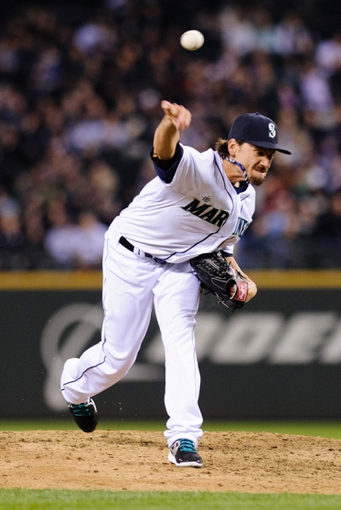Apr 8, 2014; Seattle, WA, USA; Seattle Mariners relief pitcher Danny Farquhar (40) pitches to the Los Angeles Angels during the seventh inning at Safeco Field. Mandatory Credit: Steven Bisig-USA TODAY Sports