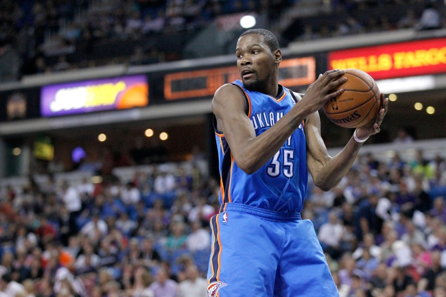 Apr 8, 2014; Sacramento, CA, USA; Oklahoma City Thunder forward Kevin Durant (35) holds onto a rebound against the Sacramento Kings in the third quarter at Sleep Train Arena. The Thunder defeated the Kings 107-92. Mandatory Credit: Cary Edmondson-USA TODAY Sports
