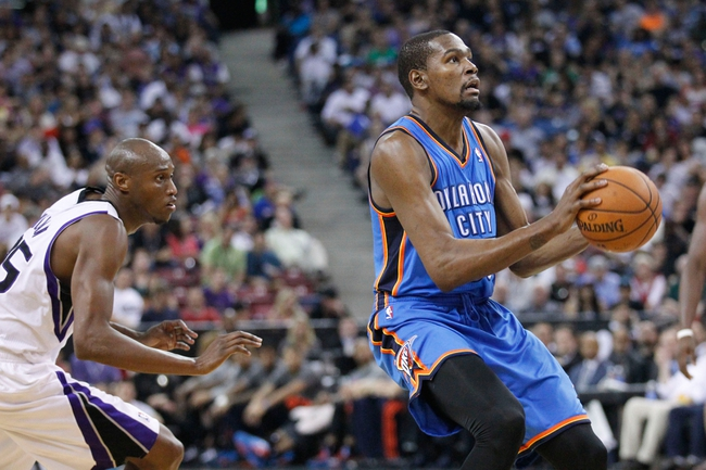 Apr 8, 2014; Sacramento, CA, USA; Oklahoma City Thunder forward Kevin Durant (35) prepares to attempt a shot against the Sacramento Kings in the third quarter at Sleep Train Arena. The Thunder defeated the Kings 107-92. Mandatory Credit: Cary Edmondson-USA TODAY Sports