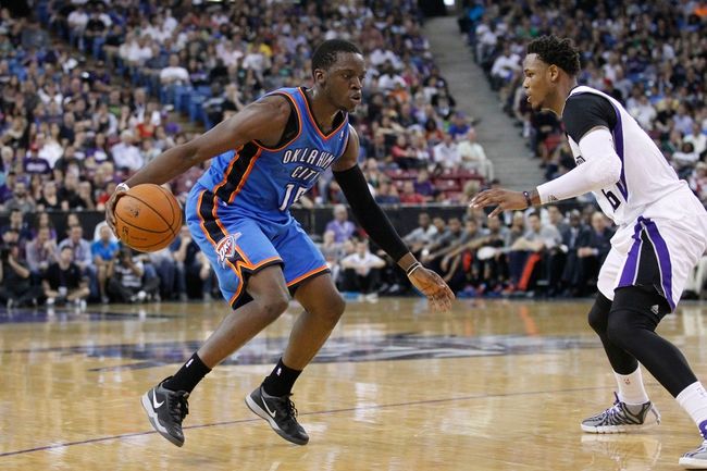 Apr 8, 2014; Sacramento, CA, USA; Oklahoma City Thunder guard Reggie Jackson (15) dribbles the ball next to Sacramento Kings guard Ben McLemore (16) in the third quarter at Sleep Train Arena. The Thunder defeated the Kings 107-92. Mandatory Credit: Cary Edmondson-USA TODAY Sports