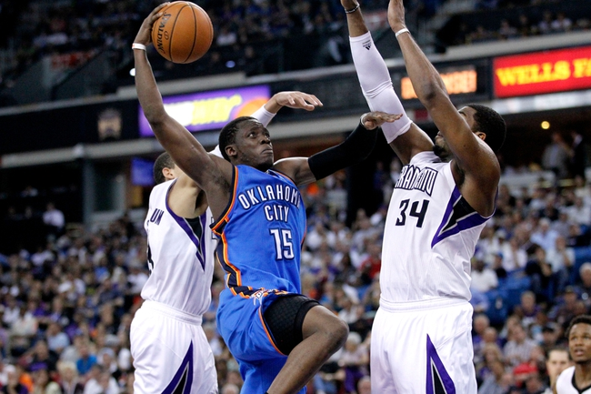 Apr 8, 2014; Sacramento, CA, USA; Oklahoma City Thunder guard Reggie Jackson (15) attempts a shot over Sacramento Kings forward Jason Thompson (34) in the third quarter at Sleep Train Arena. The Thunder defeated the Kings 107-92. Mandatory Credit: Cary Edmondson-USA TODAY Sports