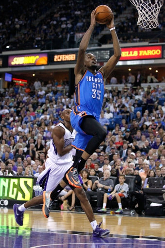 Apr 8, 2014; Sacramento, CA, USA; Oklahoma City Thunder forward Kevin Durant (35) prepares to dunk the ball against the Sacramento Kings in the third quarter at Sleep Train Arena. The Thunder defeated the Kings 107-92. Mandatory Credit: Cary Edmondson-USA TODAY Sports