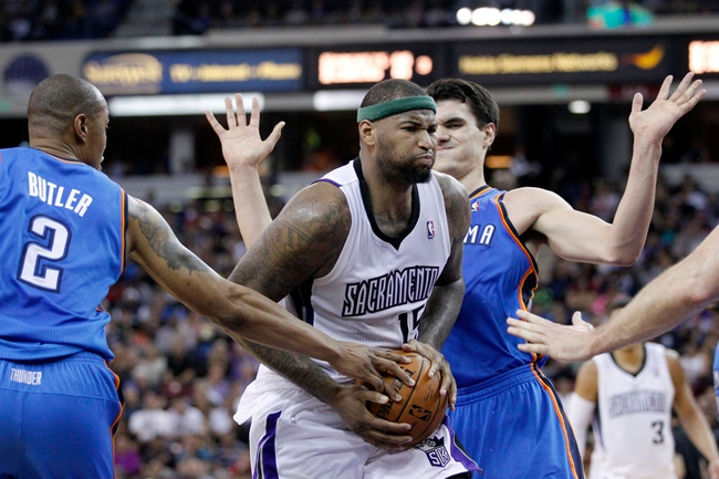 Apr 8, 2014; Sacramento, CA, USA; Sacramento Kings center DeMarcus Cousins (15) drives to the hoop against the Oklahoma City Thunder in the fourth quarter at Sleep Train Arena. The Thunder defeated the Kings 107-92. Mandatory Credit: Cary Edmondson-USA TODAY Sports