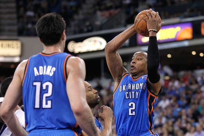 Apr 8, 2014; Sacramento, CA, USA; Oklahoma City Thunder forward Caron Butler (2) holds onto a rebound against the Sacramento Kings in the fourth quarter at Sleep Train Arena. The Thunder defeated the Kings 107-92. Mandatory Credit: Cary Edmondson-USA TODAY Sports