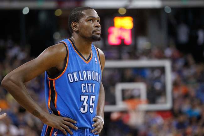 Apr 8, 2014; Sacramento, CA, USA; Oklahoma City Thunder forward Kevin Durant (35) stands on the court during a break in the action against the Sacramento Kings in the third quarter at Sleep Train Arena. The Thunder defeated the Kings 107-92. Mandatory Credit: Cary Edmondson-USA TODAY Sports