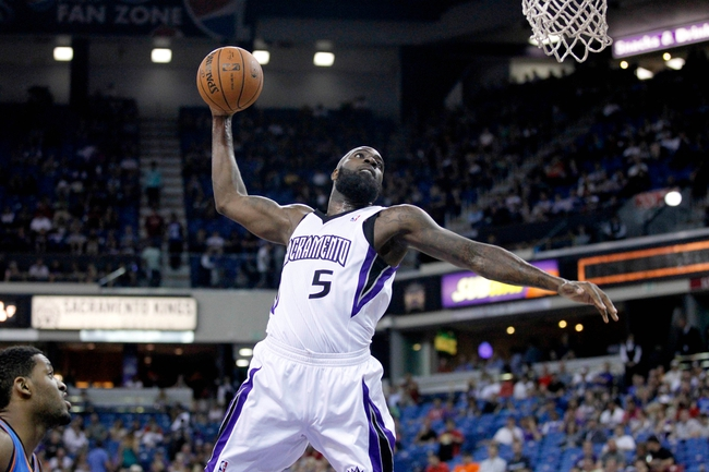 Apr 8, 2014; Sacramento, CA, USA; Sacramento Kings forward Quincy Acy (5) prepares to dunk the ball against the Oklahoma City Thunder in the fourth quarter at Sleep Train Arena. The Thunder defeated the Kings 107-92. Mandatory Credit: Cary Edmondson-USA TODAY Sports