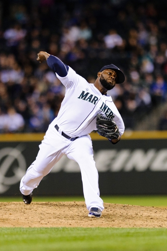 Apr 8, 2014; Seattle, WA, USA; Seattle Mariners closing pitcher Fernando Rodney (56) pitches to the Los Angeles Angels during the ninth inning at Safeco Field.  Seattle defeated Los Angeles 5-3. Mandatory Credit: Steven Bisig-USA TODAY Sports