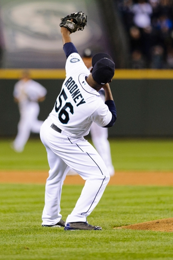 Apr 8, 2014; Seattle, WA, USA; Seattle Mariners relief pitcher Fernando Rodney (56) celebrates the final out of the game against the Los Angeles Angels at Safeco Field.  Seattle defeated Los Angeles 5-3. Mandatory Credit: Steven Bisig-USA TODAY Sports