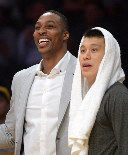 Apr 8, 2014; Los Angeles, CA, USA; Houston Rockets center Dwight Howard (left) and guard Jeremy Lin react in the fourth quarter against the Los Angeles Lakers at Staples Center. Mandatory Credit: Kirby Lee-USA TODAY Sports