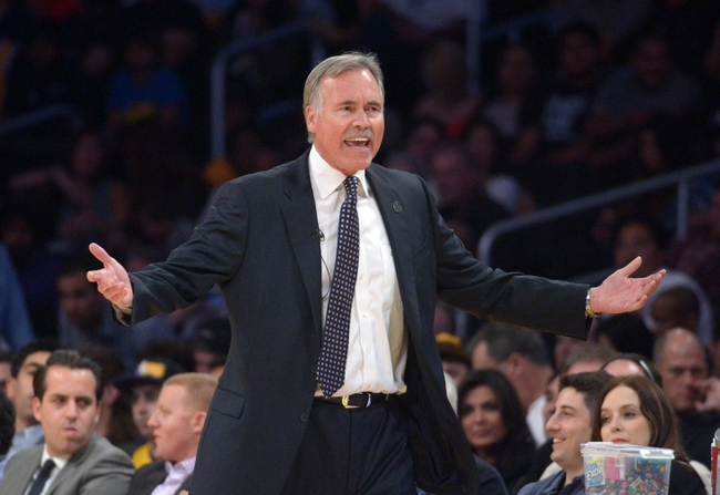 Apr 8, 2014; Los Angeles, CA, USA; Los Angeles Lakers coach Mike D'Antoni reacts during the game against the Houston Rockets at Staples Center. Mandatory Credit: Kirby Lee-USA TODAY Sports