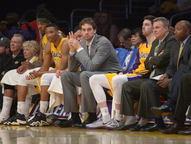 Apr 8, 2014; Los Angeles, CA, USA; Los Angeles Lakers injured forward Pau Gasol (center) watches from the bench during the game against the Houston Rockets at Staples Center. Mandatory Credit: Kirby Lee-USA TODAY Sports