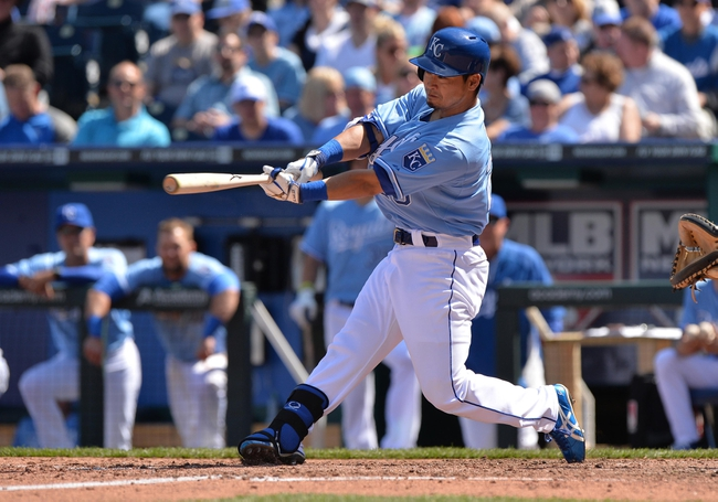 Apr 9, 2014; Kansas City, MO, USA; Kansas City Royals right fielder Nori Aoki (23) triples in a run against the Tampa Bay Rays during the fifth inning at Kauffman Stadium. Mandatory Credit: Peter G. Aiken-USA TODAY Sports