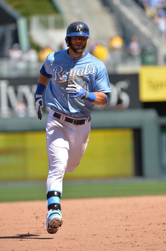 Apr 9, 2014; Kansas City, MO, USA; Kansas City Royals left fielder Alex Gordon (4) rounds the bases after hitting a three run home run against the Tampa Bay Rays during the fifth inning at Kauffman Stadium. Mandatory Credit: Peter G. Aiken-USA TODAY Sports
