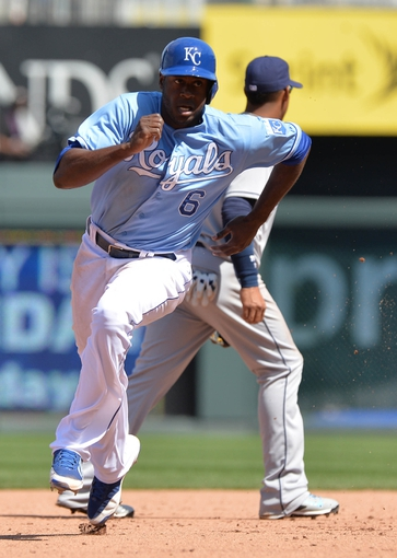 Apr 9, 2014; Kansas City, MO, USA; Kansas City Royals base runner Lorenzo Cain (6) scores on a triple from teammate Nori Aoki (not pictured) against the Tampa Bay Rays during the fifth inning at Kauffman Stadium. Mandatory Credit: Peter G. Aiken-USA TODAY Sports