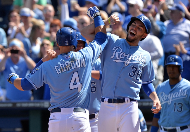 Apr 9, 2014; Kansas City, MO, USA; Kansas City Royals left fielder Alex Gordon (4) celebrates with teammate Eric Hosmer (35) after hitting a three run home run against the Tampa Bay Rays during the fifth inning at Kauffman Stadium. Mandatory Credit: Peter G. Aiken-USA TODAY Sports
