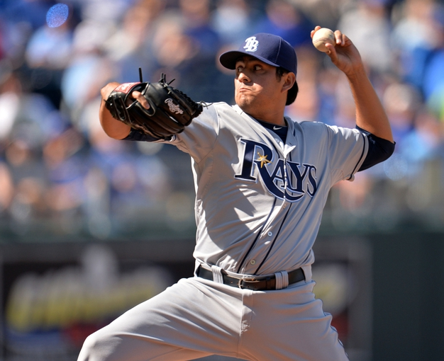 Apr 9, 2014; Kansas City, MO, USA; Tampa Rays pitcher Cesar Romos (27) delivers a pitch against the Kansas City Royals during the eighth inning at Kauffman Stadium. Kansas City won 7-3. Mandatory Credit: Peter G. Aiken-USA TODAY Sports