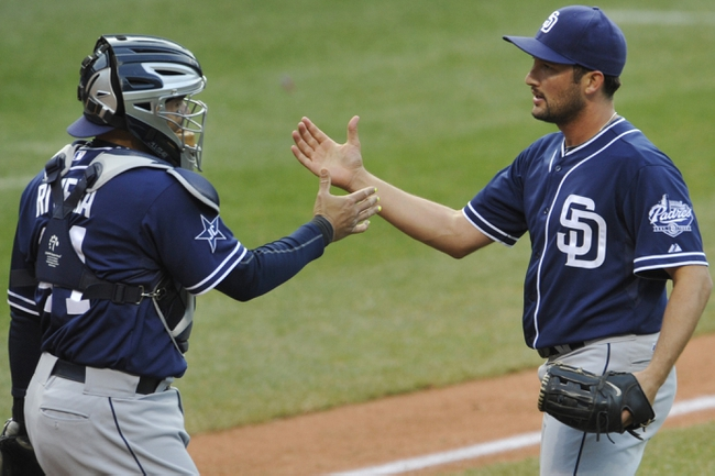 Apr 9, 2014; Cleveland, OH, USA; San Diego Padres relief pitcher Huston Street (R) celebrates with catcher Rene Rivera (44) after defeating the Cleveland Indians 2-1 at Progressive Field. Mandatory Credit: David Richard-USA TODAY Sports