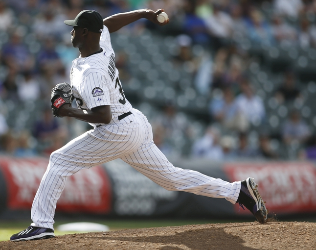 Apr 9, 2014; Denver, CO, USA;  Colorado Rockies pitcher LaTroy Hawkins (32) delivers a pitch during the ninth inning against the Chicago White Sox at Coors Field. The Rockies won 10-4.  Mandatory Credit: Chris Humphreys-USA TODAY Sports
