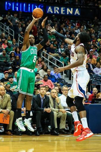 Apr 9, 2014; Atlanta, GA, USA; Boston Celtics forward Jeff Green (8) shoots a three over Atlanta Hawks forward DeMarre Carroll (5) in the first quarter at Philips Arena. Mandatory Credit: Daniel Shirey-USA TODAY Sports