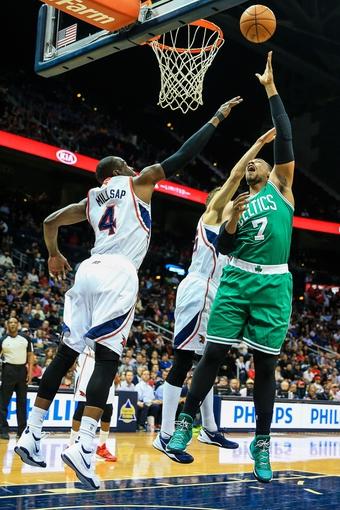 Apr 9, 2014; Atlanta, GA, USA; Boston Celtics center Jared Sullinger (7) shoots a basket past Atlanta Hawks forward Paul Millsap (4) in the first quarter at Philips Arena. Mandatory Credit: Daniel Shirey-USA TODAY Sports