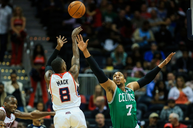Apr 9, 2014; Atlanta, GA, USA; Boston Celtics center Jared Sullinger (7) attempts to block a shot by Atlanta Hawks guard Shelvin Mack (8) in the first quarter at Philips Arena. Mandatory Credit: Daniel Shirey-USA TODAY Sports