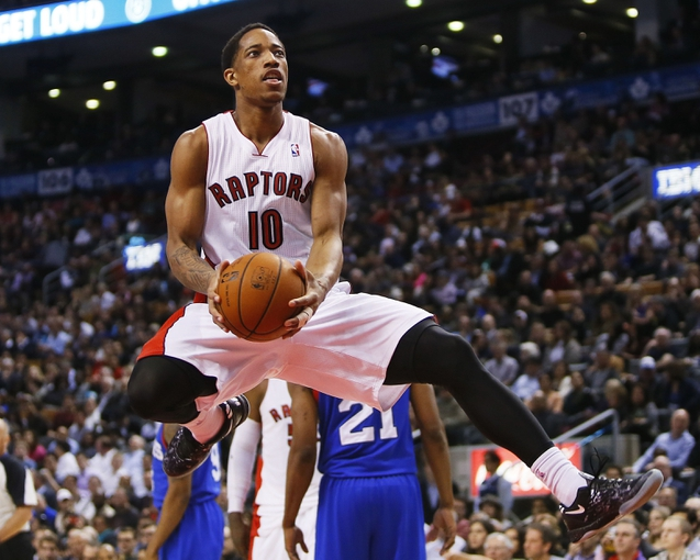 Apr 9, 2014; Toronto, Ontario, CAN; Toronto Raptors guard DeMar DeRozan (10) drives to the net against the Philadelphia 76ers during the first half at the Air Canada Centre. Mandatory Credit: John E. Sokolowski-USA TODAY Sports
