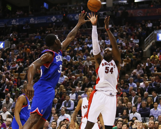 Apr 9, 2014; Toronto, Ontario, CAN; Toronto Raptors forward Patrick Patterson (54) takes as shot as Philadelphia 76ers center Henry Sims (35)  defends during the first half at the Air Canada Centre. Mandatory Credit: John E. Sokolowski-USA TODAY Sports
