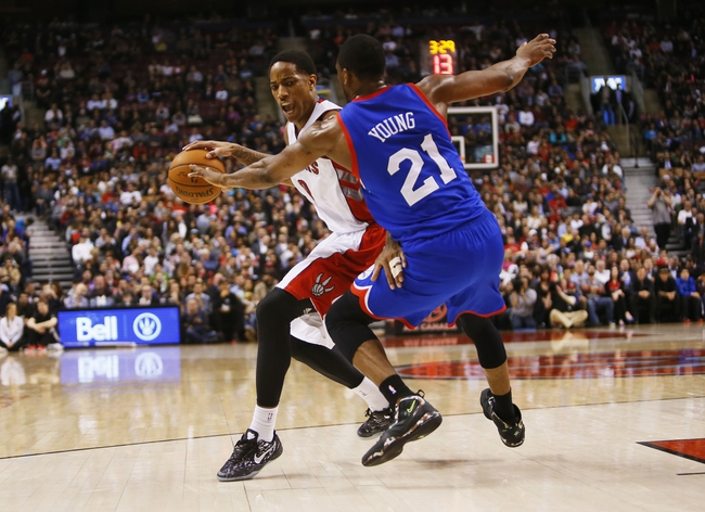 Apr 9, 2014; Toronto, Ontario, CAN; Toronto Raptors guard DeMar DeRozan (10) drives to the net against Philadelphia 76ers forward Thaddeus Young (21)  during the first half at the Air Canada Centre. Mandatory Credit: John E. Sokolowski-USA TODAY Sports