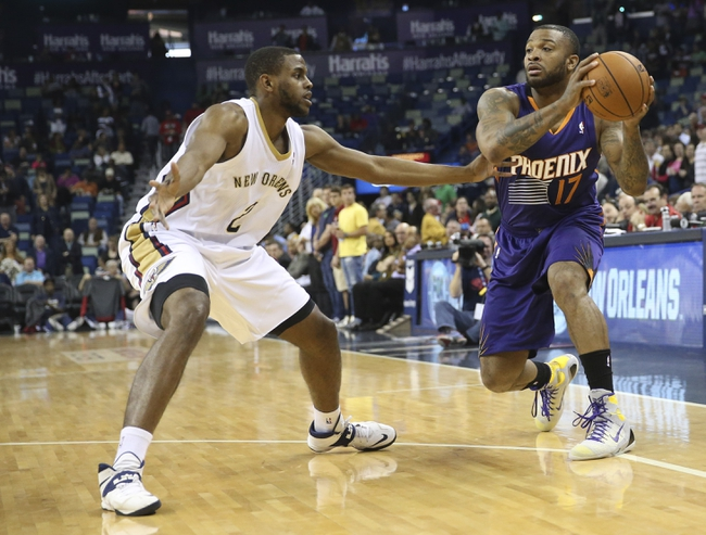 Apr 9, 2014; New Orleans, LA, USA; Phoenix Suns forward P.J. Tucker (17) is defended by New Orleans Pelicans forward Darius Miller (2) in the first half at Smoothie King Center. Mandatory Credit: Crystal LoGiudice-USA TODAY Sports