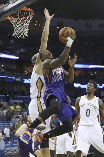 Apr 9, 2014; New Orleans, LA, USA; Phoenix Suns guard Eric Bledsoe (2) is defended under the basket in the first quarter by New Orleans Pelicans center Greg Stiemsma (34) at Smoothie King Center. Mandatory Credit: Crystal LoGiudice-USA TODAY Sports