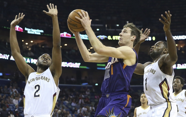Apr 9, 2014; New Orleans, LA, USA; Phoenix Suns guard Goran Dragic (1) is defended by New Orleans Pelicans forward Darius Miller (2) and forward Tyreke Evans (1) as he goes up for a basket in the first quarter at Smoothie King Center. Mandatory Credit: Crystal LoGiudice-USA TODAY Sports
