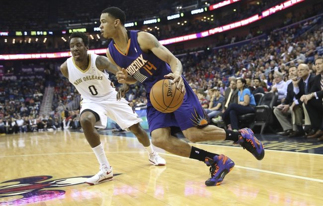 Apr 9, 2014; New Orleans, LA, USA; Phoenix Suns guard Gerald Green (14) drives toward the basket in front of New Orleans Pelicans forward Al-Farouq Aminu (0) in the first quarter at the Smoothie King Center. Mandatory Credit: Crystal LoGiudice-USA TODAY Sports
