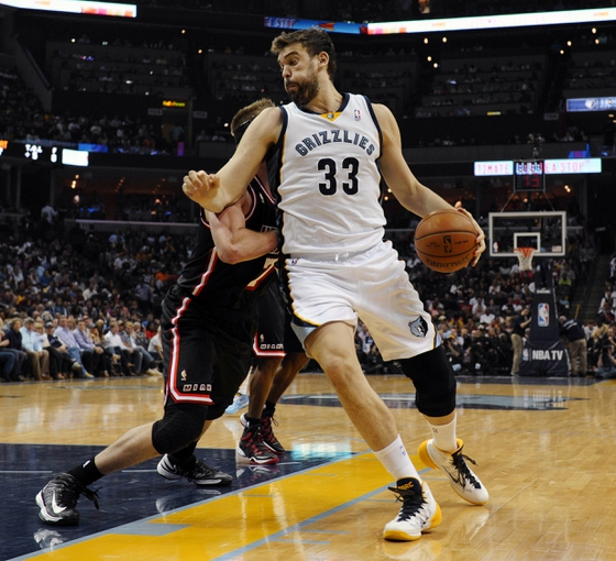 Apr 9, 2014; Memphis, TN, USA; Memphis Grizzlies center Marc Gasol (33) spins around Miami Heat center Justin Hamilton (7) during the game at FedExForum. Mandatory Credit: Justin Ford-USA TODAY Sports