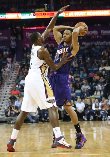Apr 9, 2014; New Orleans, LA, USA; Phoenix Suns guard Gerald Green (14) is defended by New Orleans Pelicans forward Tyreke Evans (1) in the first half at the Smoothie King Center. Mandatory Credit: Crystal LoGiudice-USA TODAY Sports