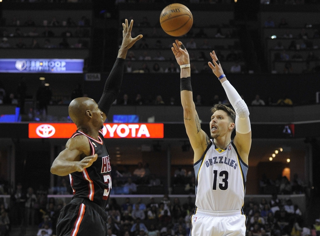 Apr 9, 2014; Memphis, TN, USA; Memphis Grizzlies forward Mike Miller (13) shoots over Miami Heat guard Ray Allen (34)during the game at FedExForum. Mandatory Credit: Justin Ford-USA TODAY Sports