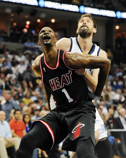 Apr 9, 2014; Memphis, TN, USA; Miami Heat center Chris Bosh (1) guards Memphis Grizzlies center Marc Gasol (33) during the game at FedExForum. Mandatory Credit: Justin Ford-USA TODAY Sports