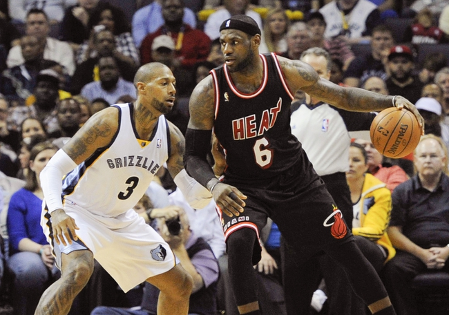 Apr 9, 2014; Memphis, TN, USA; Miami Heat forward LeBron James (6) is guarded by Memphis Grizzlies forward James Johnson (3) during the game at FedExForum. Mandatory Credit: Justin Ford-USA TODAY Sports