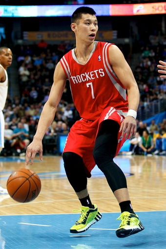 Apr 9, 2014; Denver, CO, USA; Houston Rockets point guard Jeremy Lin (7) controls the ball in the first quarter against the Denver Nuggets at the Pepsi Center. Mandatory Credit: Isaiah J. Downing-USA TODAY Sports